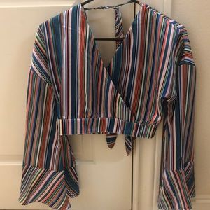 Multi color, silky cropped blouse with tie back.
